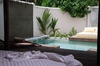 Thumb_island_villa_-_inside_deck-pool-daybed