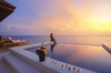 Thumb_sunsetwatersuite_exterior_sunset_withgirl